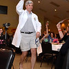 (Brad Davis/The Register-Herald) Dr. John Fernald makes his entrance during the annual event Hunks in Heels fundraising event for the Women's Resource Center Friday night at the Beckley Moose Lodge.