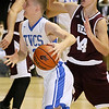 (Brad Davis/The Register-Herald) Teays Valley Christian's Noah Wimbish, a Fairdale native, drives to the basket as Virginia Episcopal's Patrick Kelly defends during the consolation game in the Battle for the Armory Basketball Tournament Friday night at the Beckley-Raleigh County Convention Center.