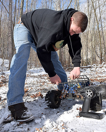 (Brad Davis/The Register-Herald) 14-year-old Joe Watson tries to get one of his much more powerful and faster gas powered 1/8 scale R.C. cars to run in the bitter cold Sunday afternoon at his Wyco Hollow Road home.