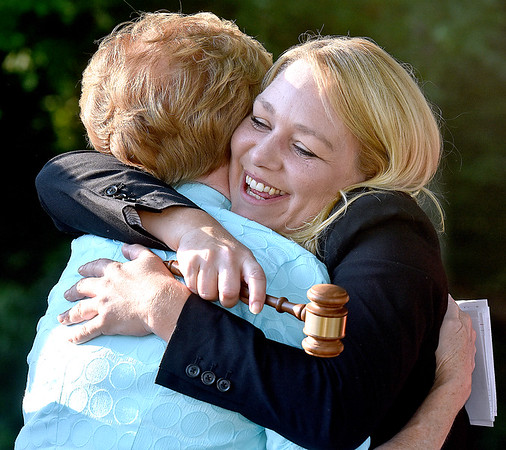 (Brad Davis/The Register-Herald) Paige Powers (right), the new President of the Beckley Board of Realtors, gets a big hug from emcee and 2017 West Virginia Association of Realtors President Glenna Swiger after receiving the ceremonial gavel during the conclusion of the board's annual installment of new officers Thursday evening at Daniel Vineyards. Powers replaces last year's president Kay Booth.