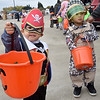 (Brad Davis/The Register-Herald) Young pirate Lincoln Nguyen, 2, knows the drill as he and elite soldier brothers Kaden (right), 3, and Jaden (unphotographed), 8, collect as much candy as possible during Tailgate Halloween Saturday afternoon atop Beckley's Intermodal Gateway.