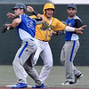 (Brad Davis/The Register-Herald) Miners baserunner Eddy Gonzalez gestures that he was safe and gets the call after managing to evade a tag at 2nd from Terre Haute infielder Joe Boyle to get the steal Friday night at Linda K. Epling Stadium.
