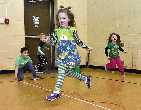 (Brad Davis/The Register-Herald) Young students run, jump and play away some extra energy during Maxwell Hill Elementary's Jumping for Hearts event Friday afternoon in the school's gymnasium. Students spent several days gathering donations for the American Heart Association by sending out e-mails, asking friends and family or even going door-to-door in their neighborhoods if they wised, raising around $5,000 overall. The annual event concluded with a special celebration in the gym where students got to run and play in a variety of jumping-related activities.