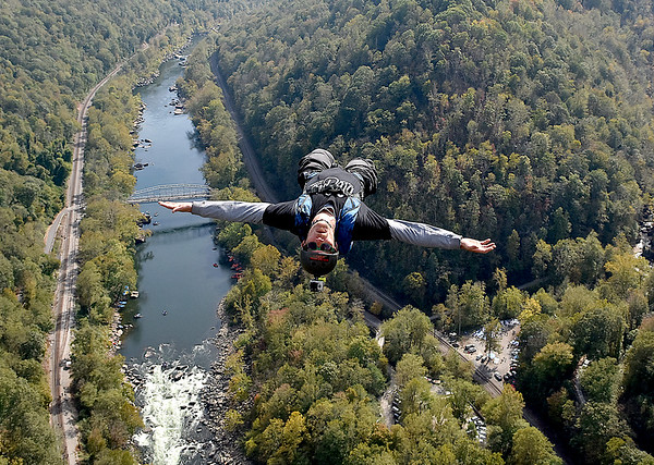 (Brad Davis/The Register-Herald) A B.A.S.E. jumper falls to earth towards the New River during Bridge Day Saturday afternoon.