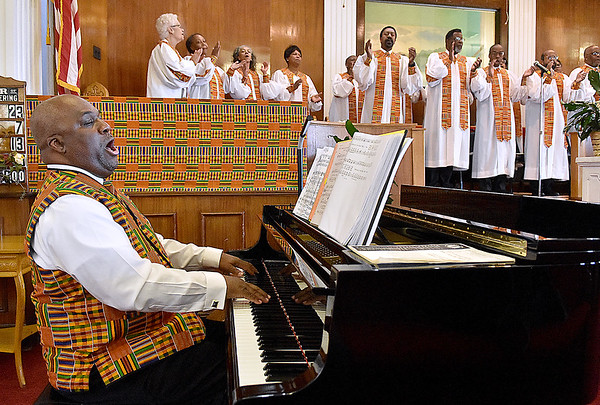 (Brad Davis/The Register-Herald) Quincy Madison, left, Minister of Music at Central Baptist Church, leads the choir on piano during the Brooks Street church's Black History Month celebration Sunday afternoon.
