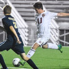 (Brad Davis/The Register-Herald) Woodrow Wilson's Ryan Akers winds up for a strike just outside the box as Shady Spring's Gavin Patton defends on Flying Eagles senior night Thursday at the YMCA Paul Cline Memorial Sports Complex.