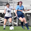 (Brad Davis/The Register-Herald) Shady Spring's Emily Stevens battles for possession with Midland Trail's Mykah Price Thursday evening at the YMCA Paul Cline Memorial Soccer Complex.