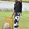 (Brad Davis/The Register-Herald) Marc Franklin indicates he's ready to hit the course after spotting the camera during BNI action Saturday afternoon at Grandview Country Club.