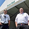(Brad Davis/The Register-Herald) First aid workers Jeff Powell, left, and Derek Thomas stand at the ready as they man the first aid tent during the Greenbrier Classic Sunday afternoon in White Sulphur Springs.