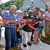 (Brad Davis/The Register-Herald) The Nicely family, surrounded by friends, cuts the ribbon during the dedication of the new Nicely Park, located in the very spot where Hershel Nicely, Nataysha Nicely and Dakota Stone were washed away Friday afternoon.