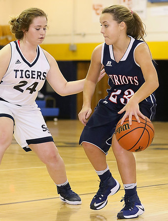 (Brad Davis/The Register-Herald) Independence's Makenzie Holley looks for an open teammate along the perimeter as Shady Spring's Anna Seabolt defends Thursday night in Shady Spring.