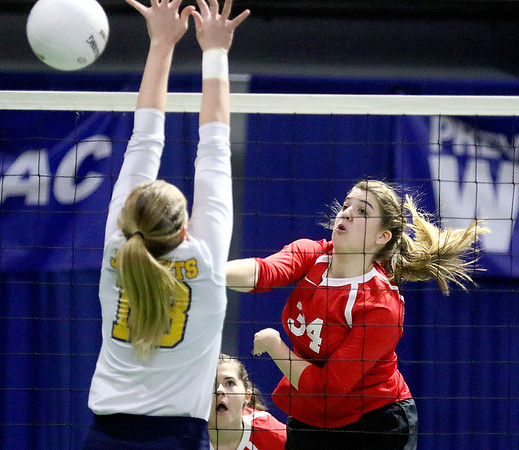(Brad Davis/The Register-Herald) Greater Beckley Christian's Lydia Jordan goes for a kill as Moorefield's Alyssa Vetter tries to block it during State Volleyball Tournament action Friday afternoon at the Charleston Civic Center.