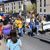 (Brad Davis/The Register-Herald) Students past and present march through campus along Kanawha street during WVU Tech's first homecoming parade in Beckley Saturday morning.