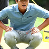 Danny Lee looks over his putt on the first hole during the third round of The Greenbriewr Classic.<br /> (Rick Barbero/The Register-Herald)