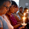 (Brad Davis/The Register-Herald) Citizens take part in a moment of silence during a candlelight vigil for victims of hate and violence that unfolded during the weekend in Charlottesville, Va., as well victims of hate and violence around the country Wednesday night at St. Stephens Episcopal Church in Beckley. The event featured several speakers including Joan C. Browning, one of nine Albany (Georgia) Freedom Riders, and an open forum with a panel of local leaders discussing race relations and other key issues at the conclusion.