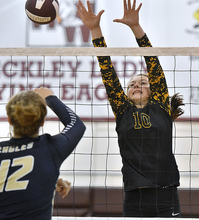 (Brad Davis/The Register-Herald) Greenbrier East's Karlei Shaver blocks a spike attempt from Hedgesville's Kelsey Turben during the Shirley Brown Invitational Volleyball Tournament Saturday afternoon at Woodrow Wilson High School.