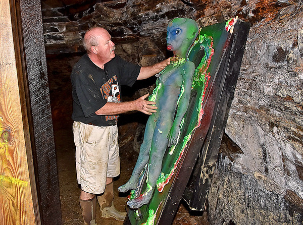(Brad Davis/The Register-Herald) Jim Oaks, a veteran in the field of creating spooky experiences, looks over some of the props that will be terrifying visitors inside the Beckley Haunted (a.k.a. Exhibition) Coal Mine during preparations Thursday evening. Oaks was the mastermind behind the haunted mine during its first years in 1999, 2000 and 2001, returning this year to contribute once again. The Haunted Mine opens this evening at 6:00 p.m. and will include local performers from Theatre West Virginia and Woodrow Wilson High School.