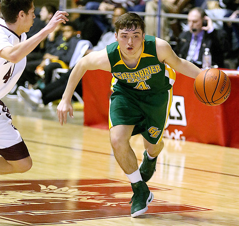 (Brad Davis/The Register-Herald) Greenbrier East's Nathaniel Patton rushes up the court as Woodrow Wilson's Bryce Radford defends Saturday night at the Beckley-Raleigh County Convention Center.
