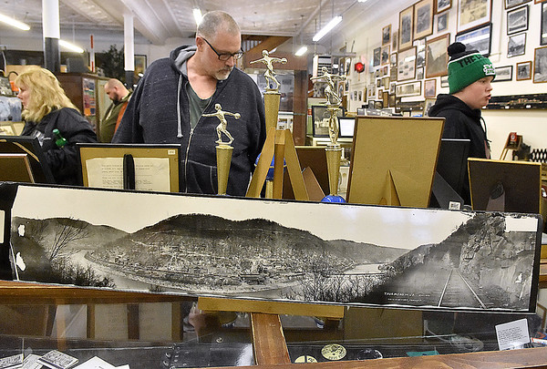 (Brad Davis/The Register-Herald) Visitors meander through the Railroad Museum as they get a look at tons of historic photographs and other interesting items on display during Hinton Railroad Days Sunday afternoon.