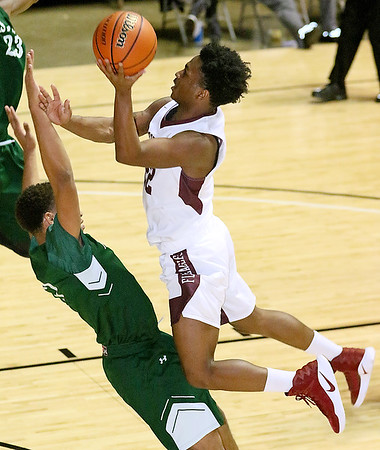 (Brad Davis/The Register-Herald) Woodrow Wilson's Isaiah Francis drives to the basket as First Love Christian's Christian Bentley defends during the championship game of the Battle for the Armory Basketball Tournament Friday night at the Beckley-Raleigh County Convention Center.