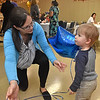 (Brad Davis/The Register-Herald) One-year-old Eli McClain gets his own balloon from his mom Melanie during St. Stephens Episcopal Church Day School's 60th anniversary celebration Sunday afternoon.