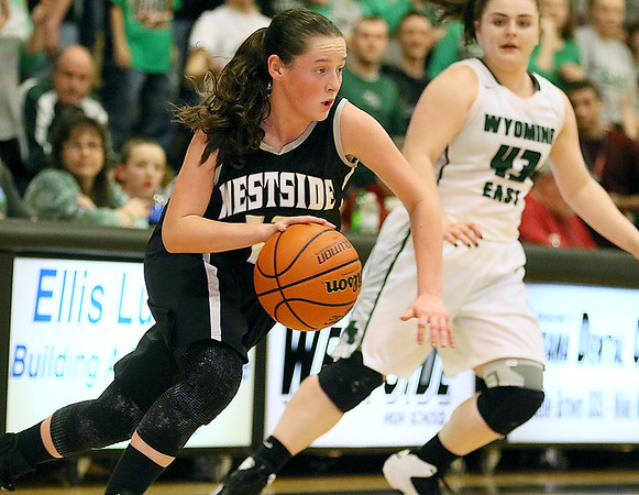 (Brad Davis/The Register-Herald) Westside's Makayla Morgan drives during the Renegades' sectional championship win over county rival and defending state champion Wyoming East Wednesday night in Clear Fork.