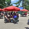 (Brad Davis/The Register-Herald) Fans chill out, enjoy concessions and watch the action on a big screen in the commons area during the Greenbrier Classic Sunday afternoon in White Sulphur Springs.