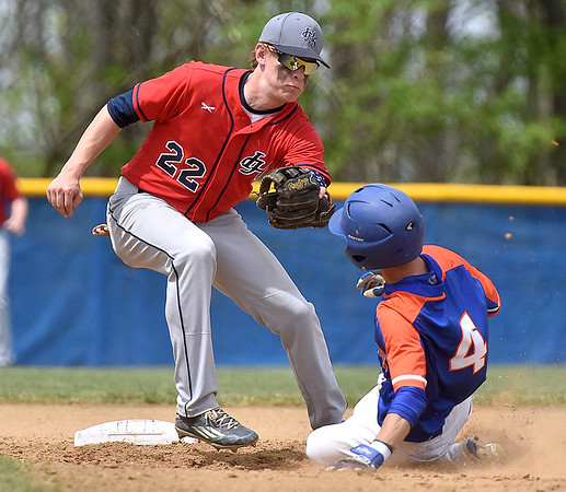 (Brad Davis/The Register-Herald) Independence second baseman Logan Stump turns to tag out Princeton's Logan Austin as he attempts to steal during the Jeff Treadway Memorial Wooden Bat Tournament Saturday afternoon in Coal City.