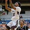 (Brad Davis/The Register-Herald) Woodrow Wilson's Mikey Penn drives to the basket as Riverside's Dom Reed can only watch during the Flying Eagles' win over the Warriors Wednesday night at the Beckley-Raleigh County Convention Center.