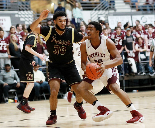 Woodrow's Breland Walton tries to get past George Washington's (30) during their regional final Tuesday in Beckley. (Chris Jackson/The Register-Herald)