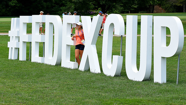 Kirsten Vest watches play near the 17th fairway during the third round of The Greenbrier Classic.<br /> (Rick Barbero/The Register-Herald)