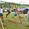 (Brad Davis/The Register-Herald) Jumping Branch resident Wilma Lilly, right, hangs out wih granddaughters Samantha Rodes (left), 9, and Abigail Rodes, 10, who came all the way from Niantic, Connecticut during the annual Lilly Family Reunion Saturday afternoon.