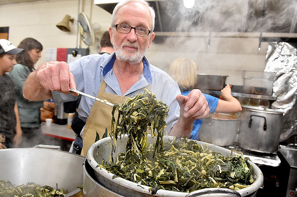 Ramp chef John McClung shows off a scoop of freshly cooked ramps inside the kitchen of Cherry River Elementary School during Richwood's 79th Annual Feast of the Ramson Saturday afternoon.