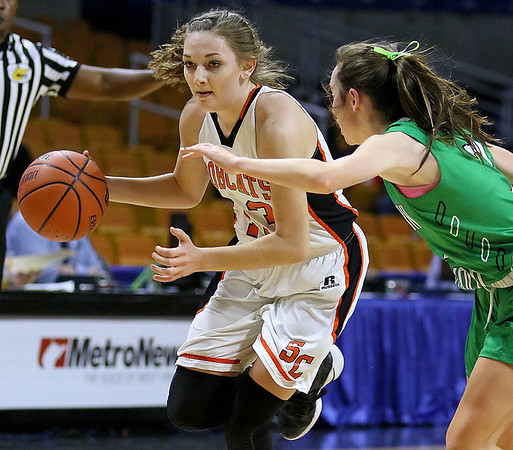 (Brad Davis/The Register-Herald) Summers County's Hannah Taylor hustles around Charleston Catholic's Mills Mullen during the Lady Bobcats' opening round State Tournament win over the Irish Wednesday evening at the Charleston Civic Center.