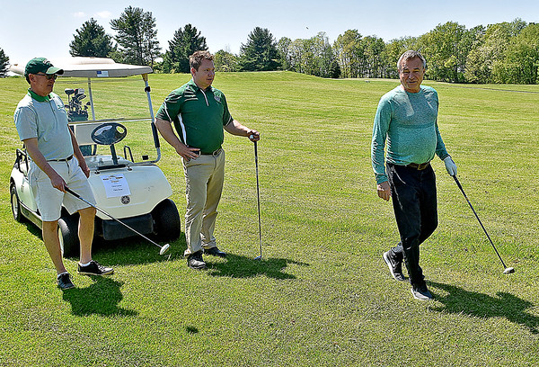 (Brad Davis/The Register-Herald) Men's basketball coach Dan D'Antoni (right) talks with group mates Chris Leister, left, and Chris Grose as they look for their shots during the 27th Annual Beckley Athletic Club of Marshall University (BAC-MU) Big Green Golf Outing Monday afternoon at Grandview.