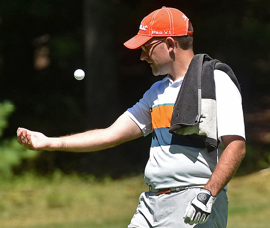 (Brad Davis/The Register-Herald) Aaron Kemlock tosses the ball up and kicks it back to his hand with his bicep between holes during BNI action Sunday afternoon at Glade Springs' Stonehaven Golf Course.