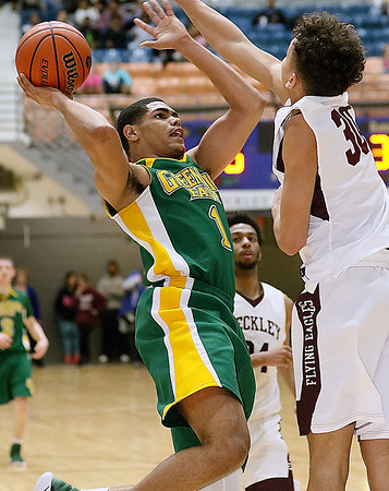 (Brad Davis/The Register-Herald) Greenbrier East's Jasiah Rawls drives to the basket as Woodrow Wilson's Eddie Christian defends Friday night at the Beckley-Raleigh County Convention Center.