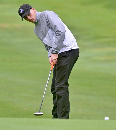 (Brad Davis/The Register-Herald) Landon Perry watches his putt during BNI action Saturday afternoon at Grandview Country Club.