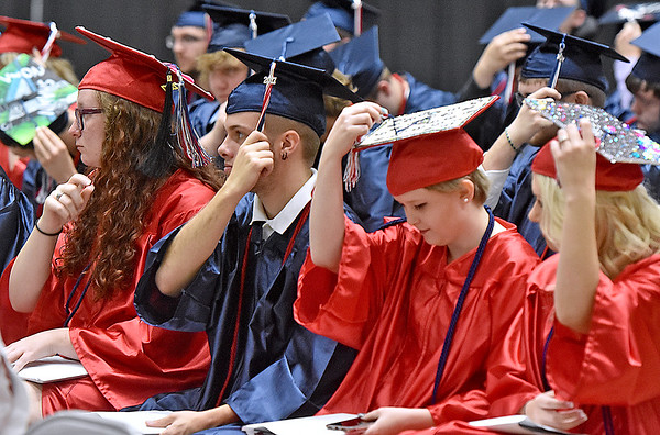 (Brad Davis/The Register-Herald) Independence seniors turn their tassels during the closing moments of the school's 41st Commencement Saturday morning at the Beckley-Raleigh County Convention Center.