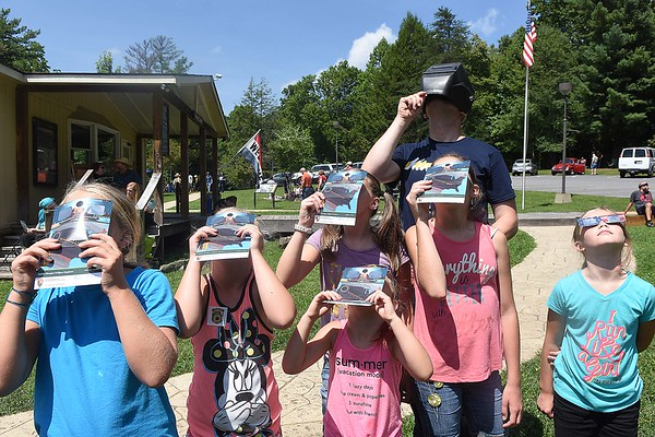 Spectators view the solar eclipse Monday afternoon at Grandview State Park<br /> (Rick Barbero/The Register-Herald)