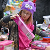 (Brad Davis/The Register-Herald) Nine-year-old Hailie Vandal checks out toys during the annual Mac's Toy Fund event Saturday morning at the Beckley-Raleigh County Convention Center.