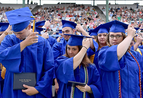 (Brad Davis/The Register-Herald) Graduating Greenbrier West High School Seniors turn their tassels at the conclusion of the school's 2017 Commencement Ceremony Saturday evening at the State Fairgrounds in Fairlea.