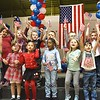 "Kindergarten class at Lester Elementary School waved flags and sang ""When the Flag Goes By"" during a Vereran's Day program held at Lester Elementary School Wednesday afternoon.<br /> (Rick Barbero/The Register-Herald"