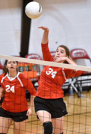 (Brad Davis/The Register-Herald) Greater Beckley Christian's Lydia Jordan, right, spikes the ball against Ravenswood Saturday afternoon in Prosperity.