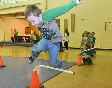(Brad Davis/The Register-Herald) Kindergartener Connor Hubbard clears another obstacle as he jumps away some extra energy during Maxwell Hill Elementary's Jumping for Hearts event Thursday afternoon in the school's gymnasium. Students spent several days gathering donations for the American Heart Association by sending out e-mails, asking friends and family or even going door-to-door in their neighborhoods if they wised, raising around $5,000 overall. The annual event concluded with a special celebration in the gym where students got to run and play in a variety of jumping-related activities.