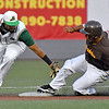 (Brad Davis/The Register-Herald) Miners 2nd baseman Ivan Acuna is just late with the tag as Kokomo's Romero Harris steals 2nd Friday night at Linda K. Epling Stadium.