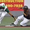 (Brad Davis/The Register-Herald) Miners 2nd baseman Ivan Acuna is just late with the tag as Kokomo's Romero Harris steals 2nd Friday night at Linda K. Epling Stadium.