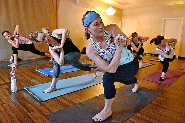 (Brad Davis/The Register-Herald) Instructor Cathy Underwood leads a class at Balanced Life Yoga September 8.