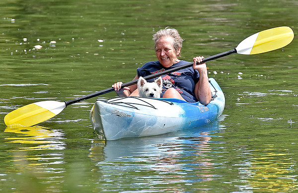 (Brad Davis/The Register-Herald) Huntington resident Darla Slater and companion Peggy finish the long portion of the kayak race Sunday afternoon in Alderson.