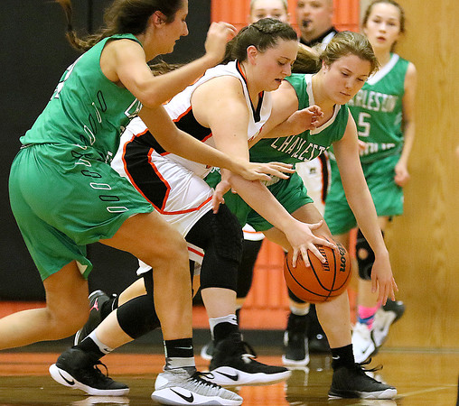 (Brad Davis/The Register-Herald) Summers County's Erica Merrill battles for a loose ball with Charleston Catholic's Vida Imani, left, and Anna Hewitt during the Lady Bobcats' win over the Irish Saturday night in Hinton.